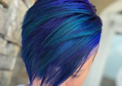Blue and multicolored hair styled at eleven salon